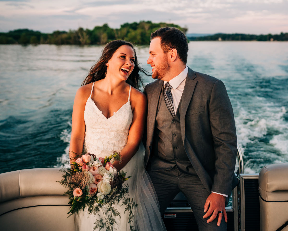Bride and groom on a boat in love