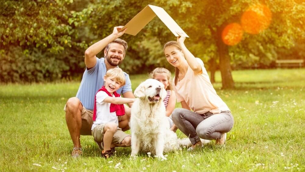 Family and dog holding a roof over their head