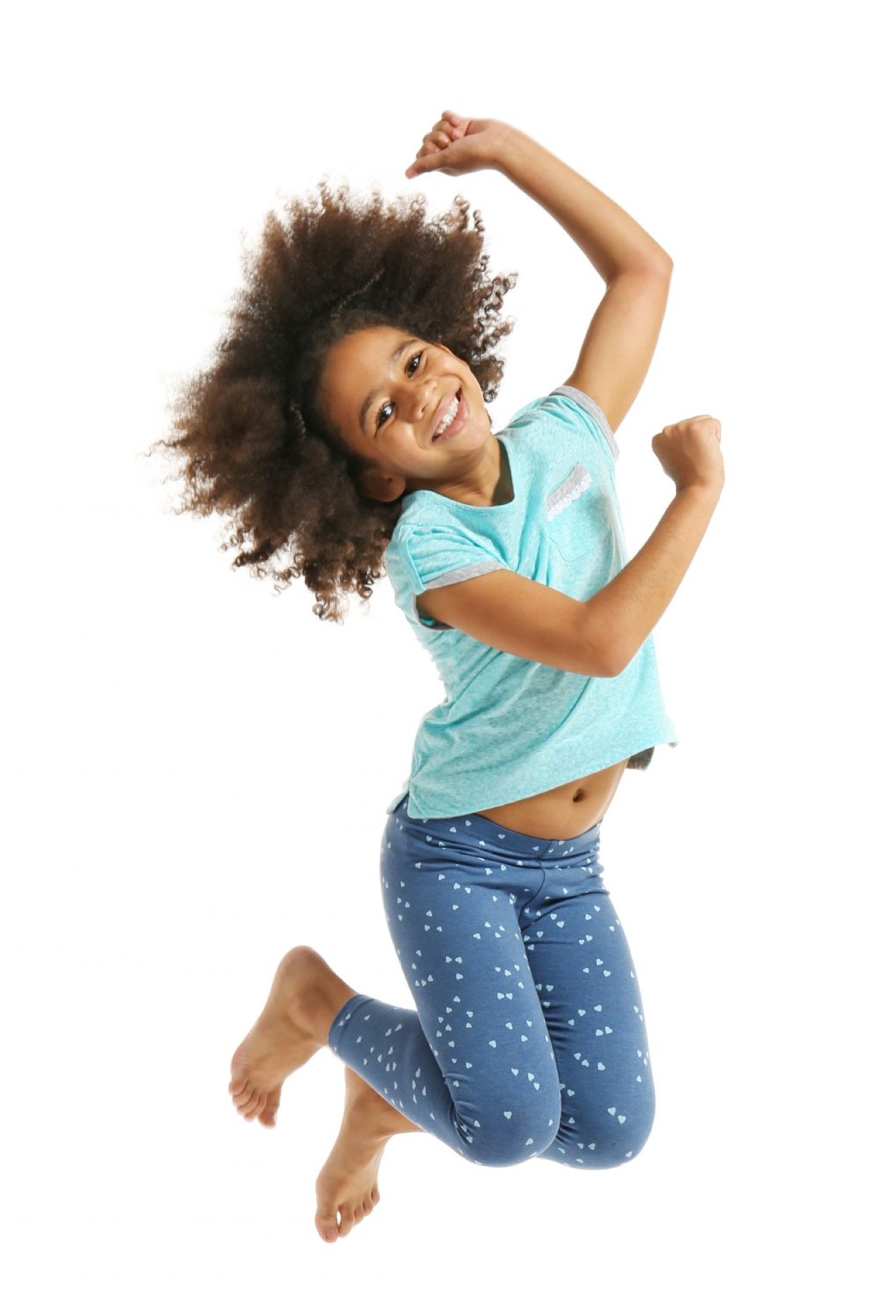 child jumping in mid air