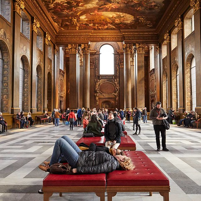 people marvelling at the brilliant painted hall