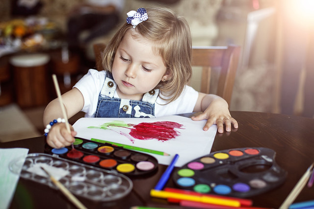 Young girl painting doing arts and crafts