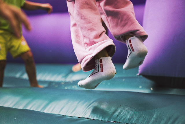 Child bouncing on a trampoline at Flip Out