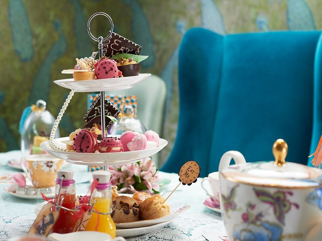 Selection of pastries and cakes on a stand for the Alice in Wonderland Tea at the Taj Hotel