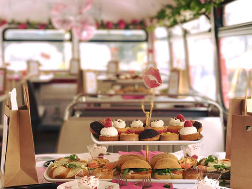 A tray of afternoon tea treats on a B Bakery Bus