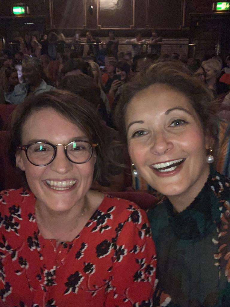 Two women smiling at The London Palladium