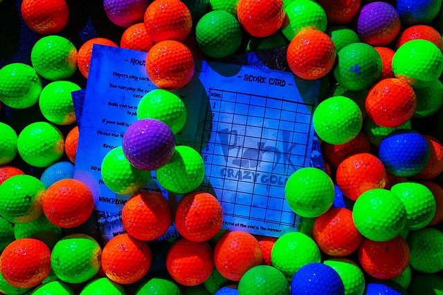 Neon golf balls and a sheet for Plonk Crazy Golf