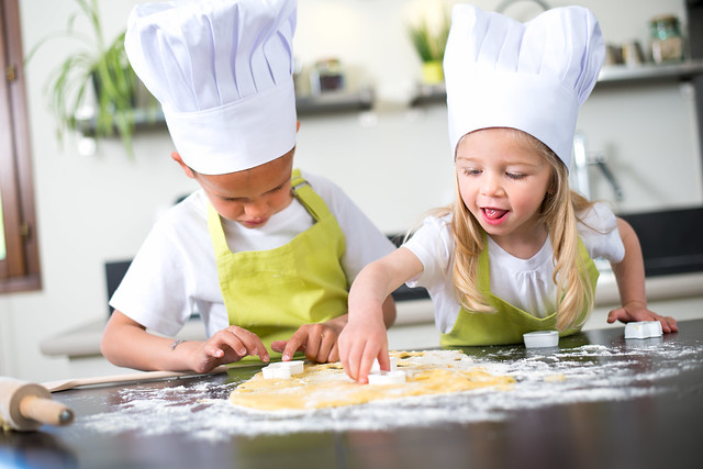 two children cooking in the kitchen