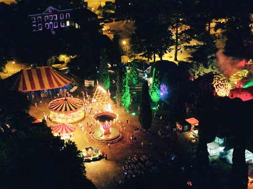 Horsham park filled with rides at nighttime for Enchanted Horsham festival