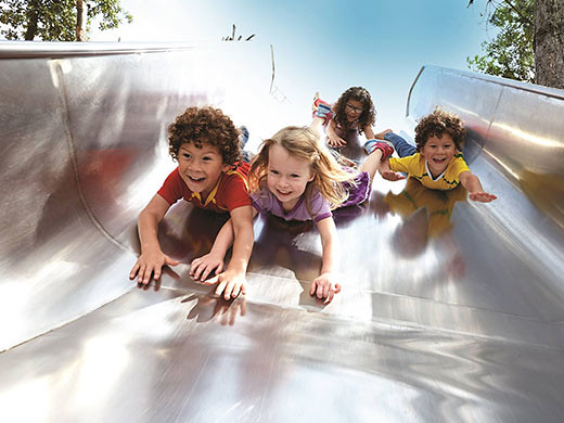 kids sliding down the slide at queen elizabeth olympic park