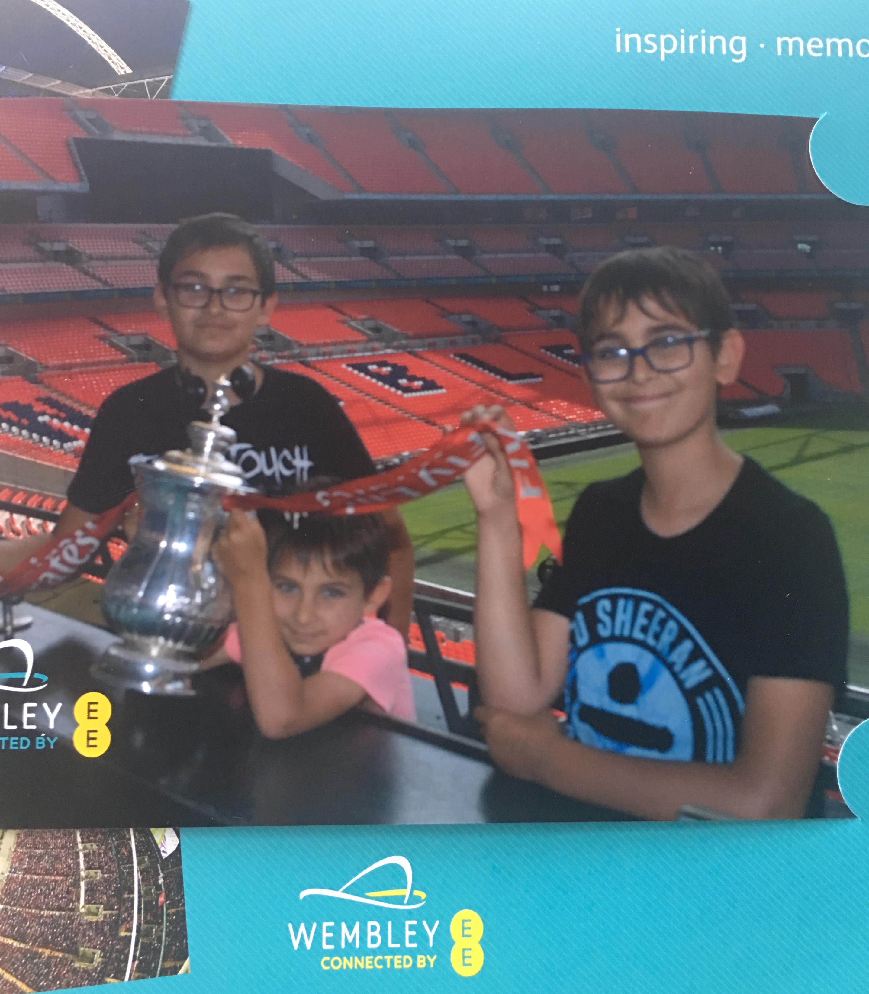 three brothers posing with the FA cup