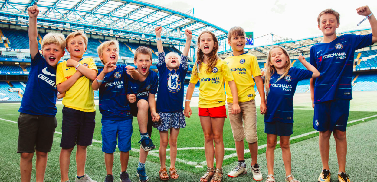 Chelsea fans on a behind the scenes tour of Stamford Bridge cheering