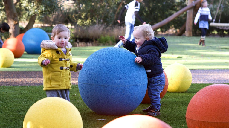 toddlers playing at new children's garden at kew gardens