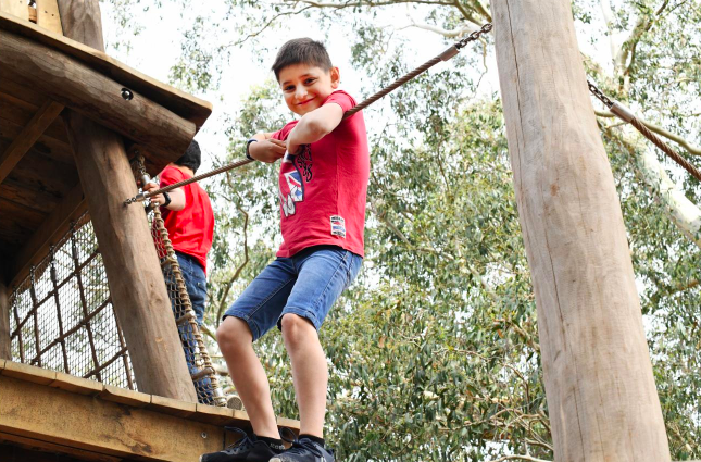 boy on high ropes course at kew gardens new childrens playground