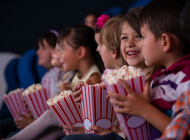 kids eating popcorn at the cinema at science museum