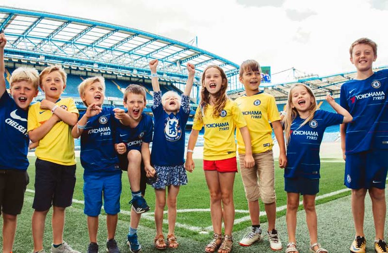 Kids cheering at the Chelsea Stadium