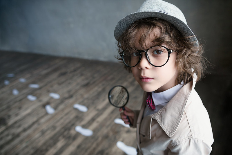 little boy magnifying glass spying imagine festival southbank centre
