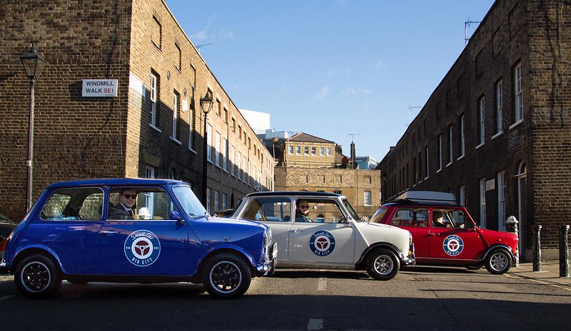 Restored Classic Mini Coopers with Small Car Big City
