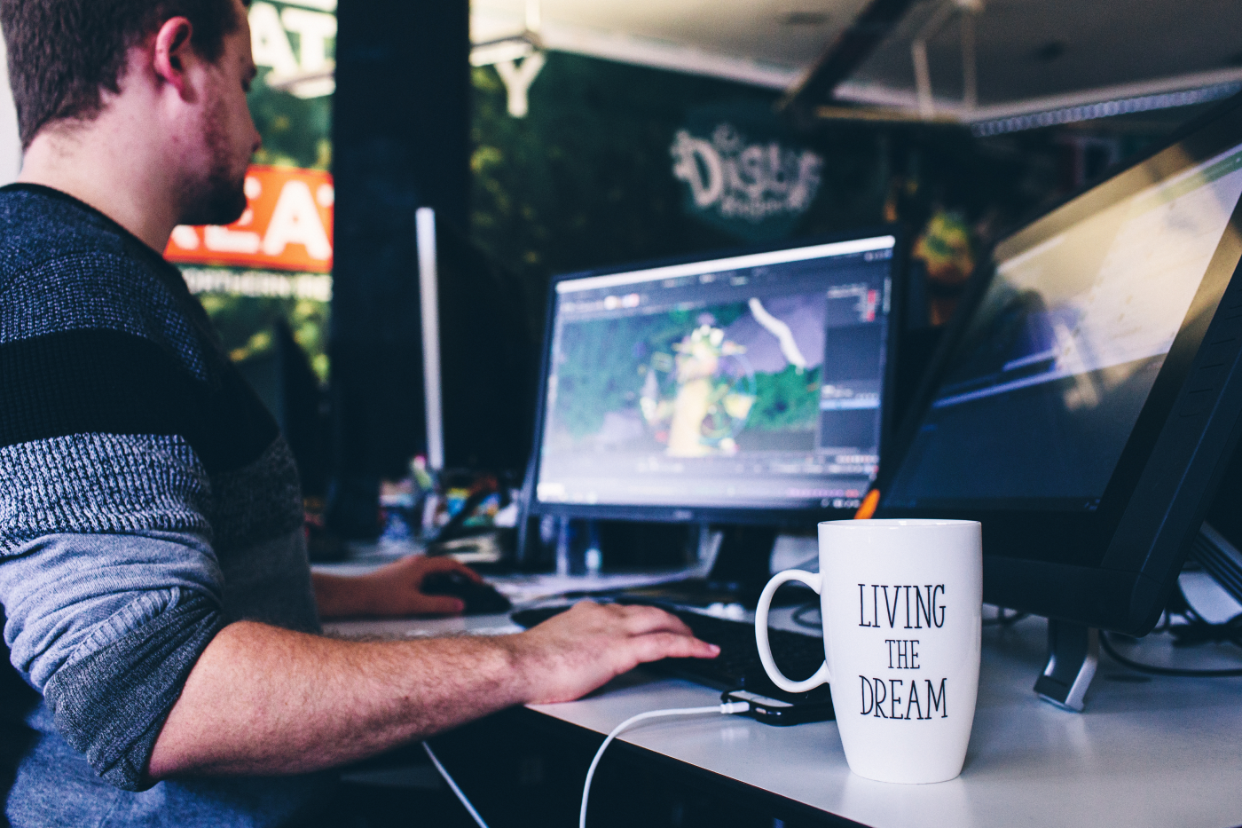 White male animator working at a desk in a creative studio