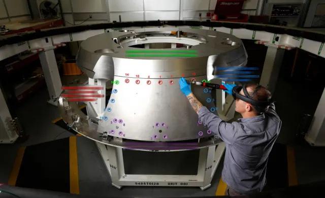An engineer at Lockheed Martin using Microsoft's HoloLens 2, a mixed reality headset