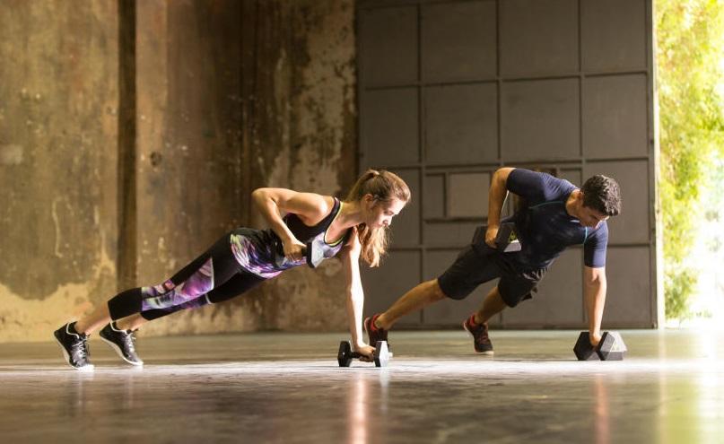 Dumbbell back plank exercise