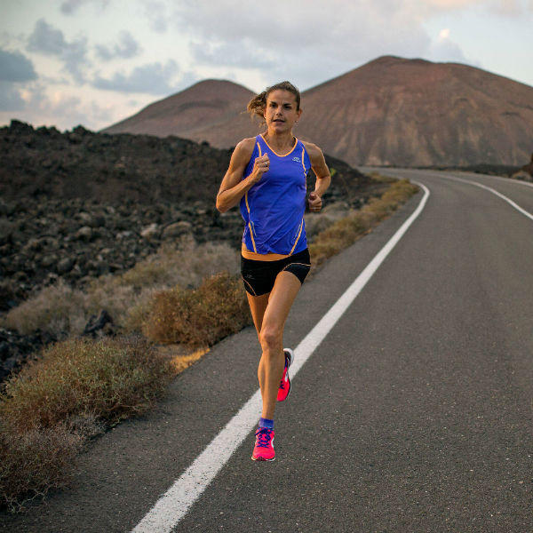 Woman running on the road track