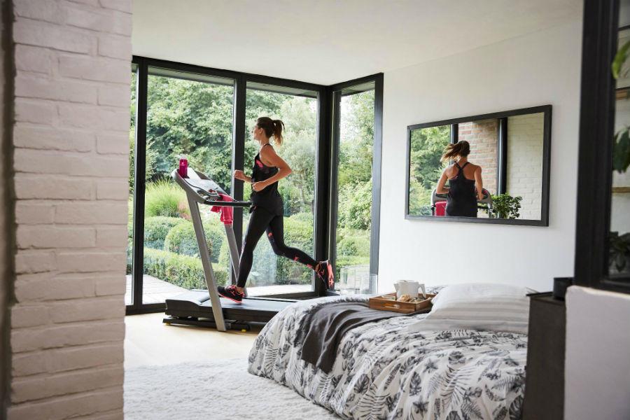 Women running on treadmill in her home