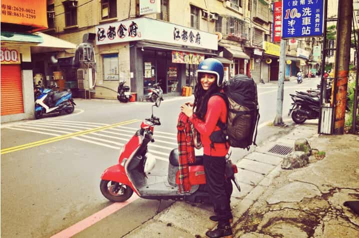 Girl with a red scooter