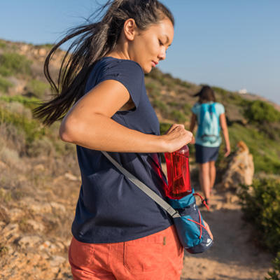 Girl hiking with a water bottle