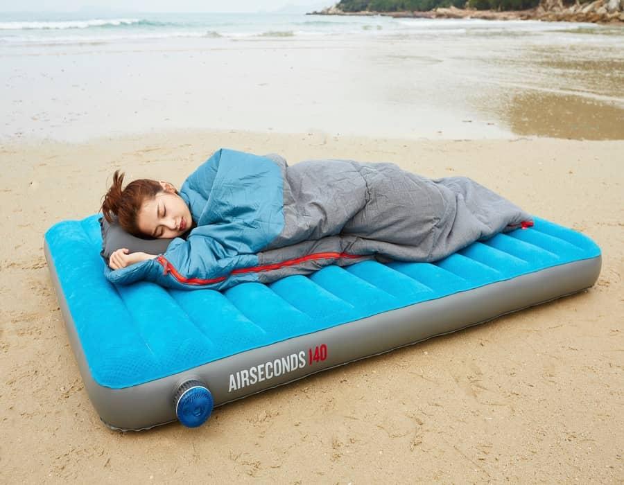 girl sleeping on a beach