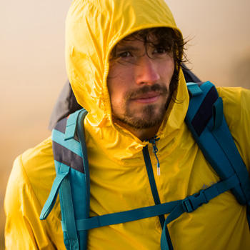 man wearing hiking rain gear