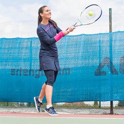 girl playing lawn tennis