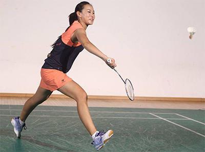 girl hitting badminton shot