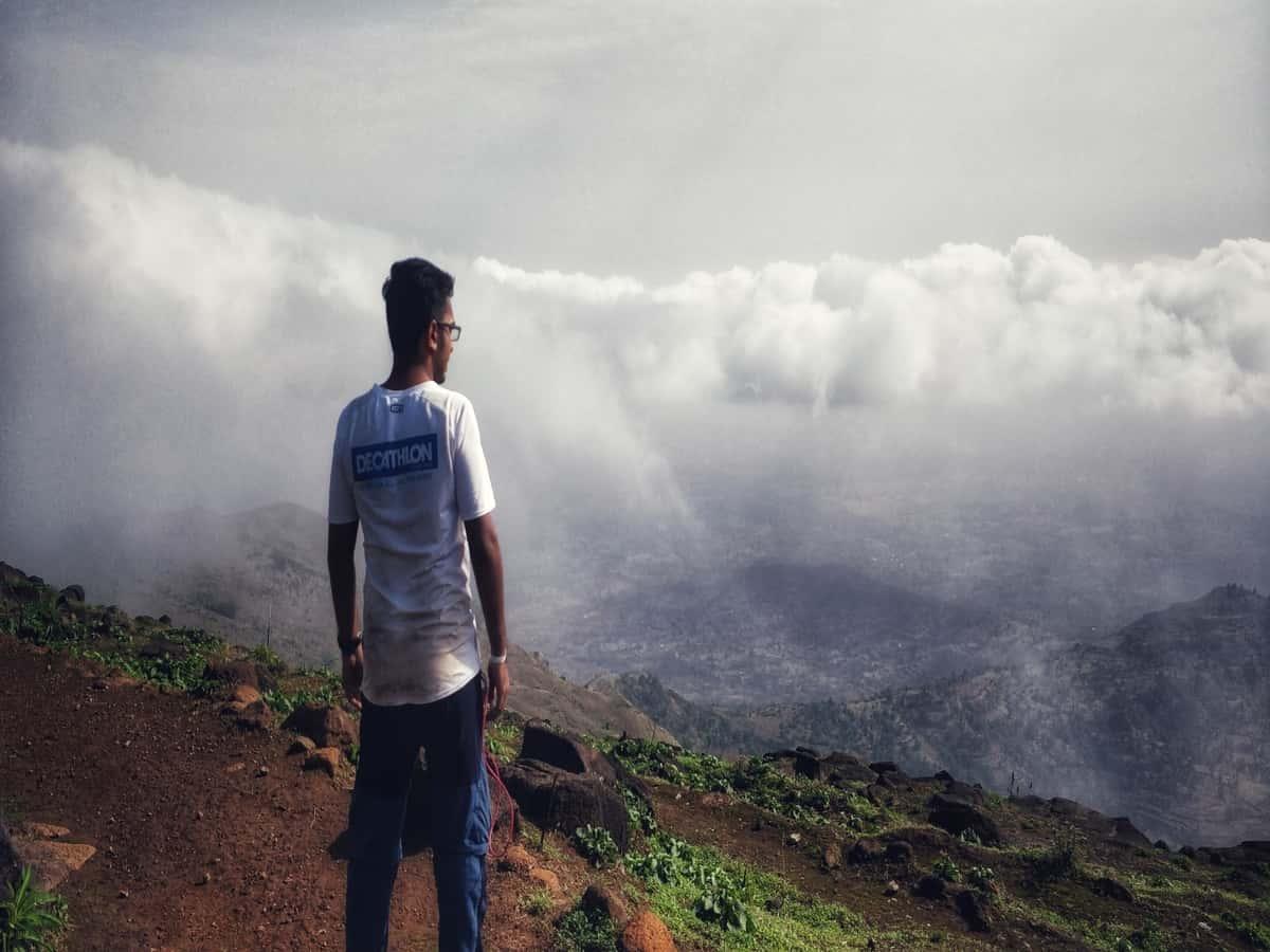 man standing at Kalsubai peak