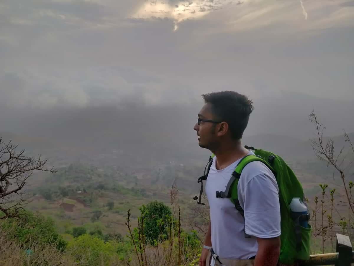 Boy looking down from Kalsbai Peak