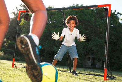 kid stopping the football goal