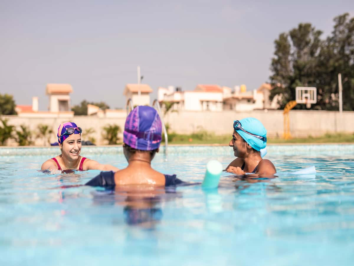 women having fun in the swimming pool