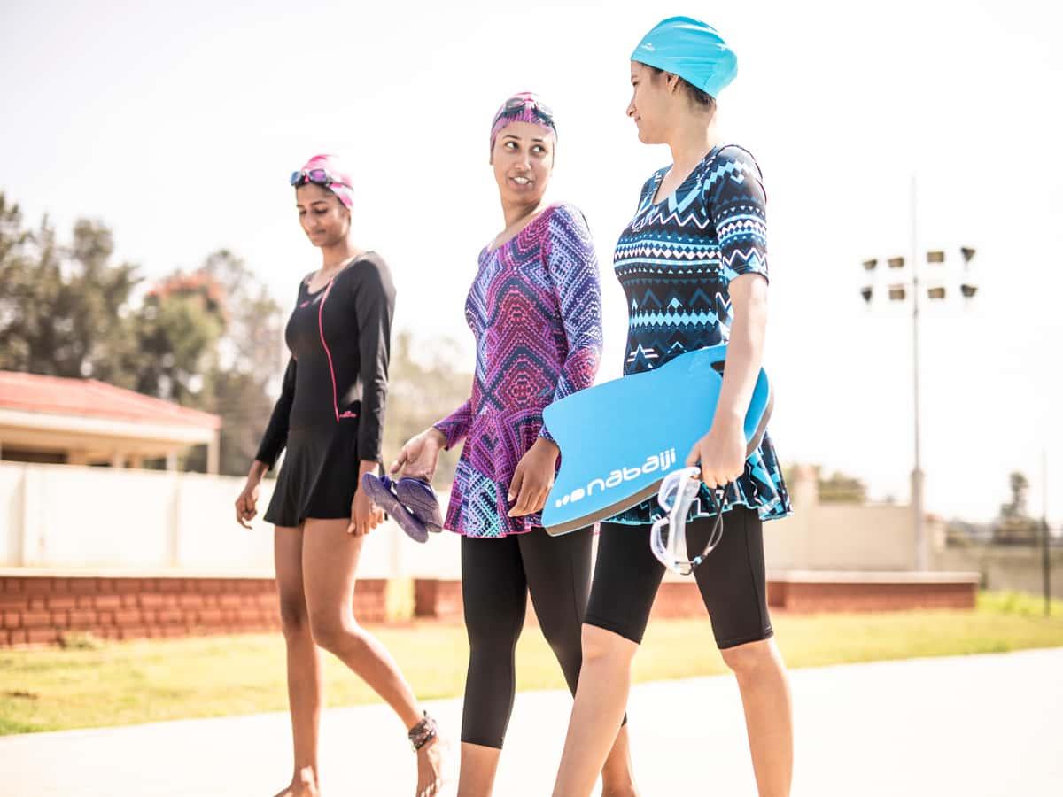women walking outside the pool