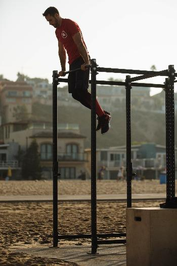 man preparing for muscle up exercises