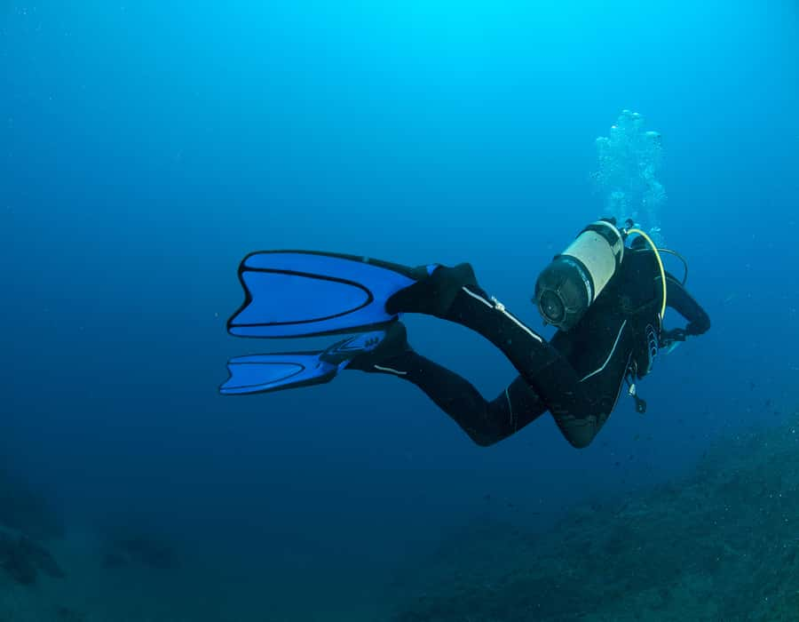 Scuba diving in blue water