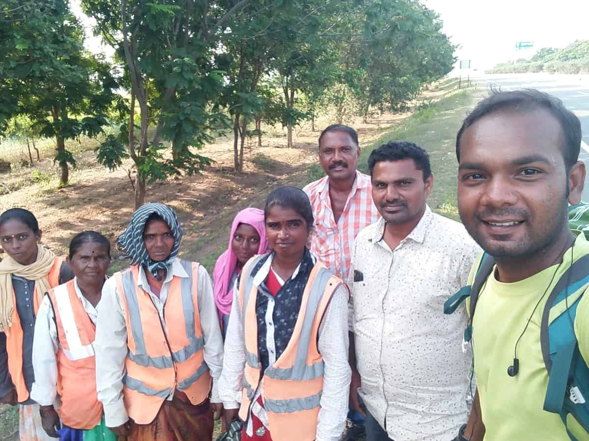 Suresh Daniel taking a selfie with village people