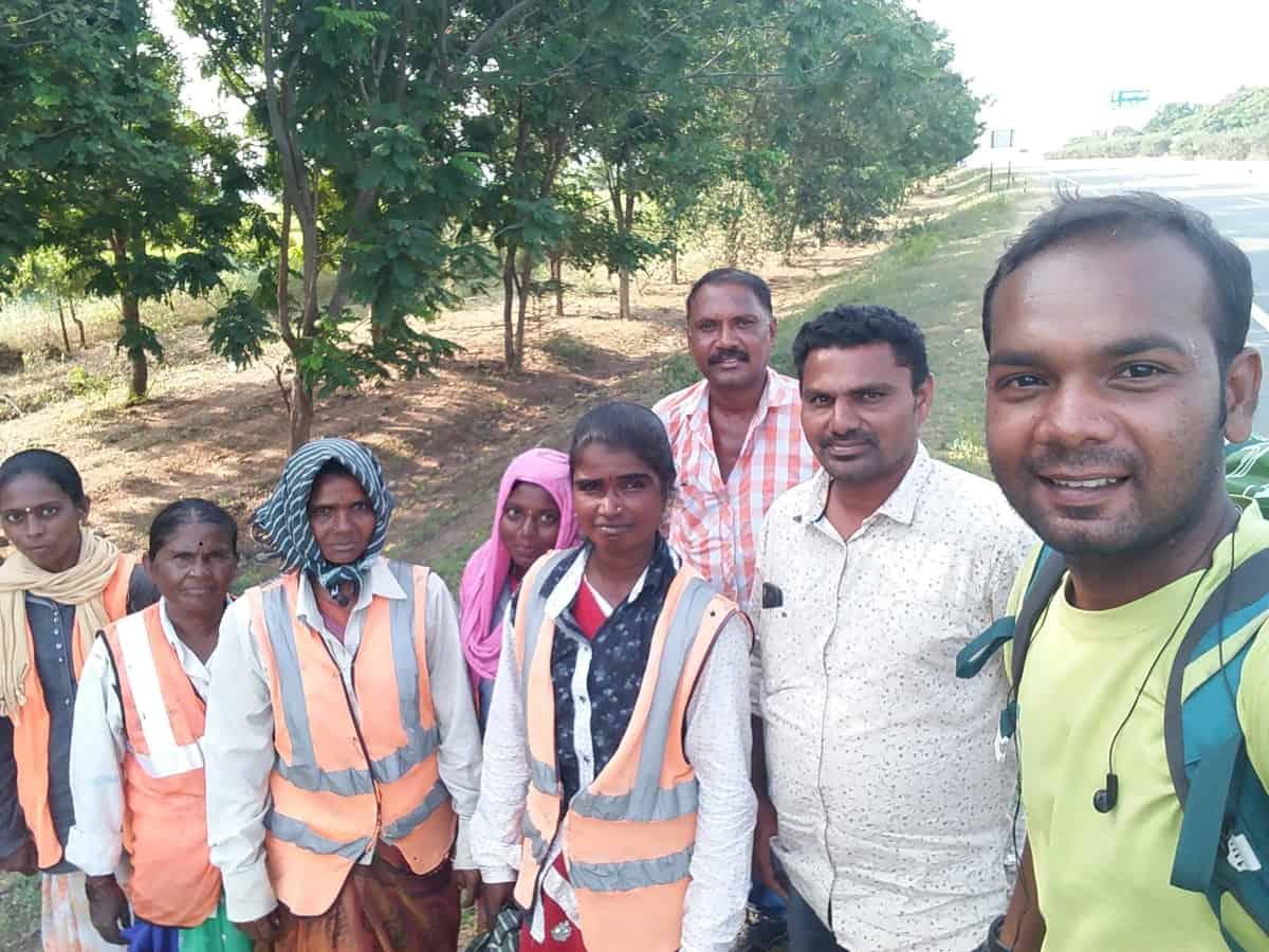 Suresh Daniel taking a selfie with village people