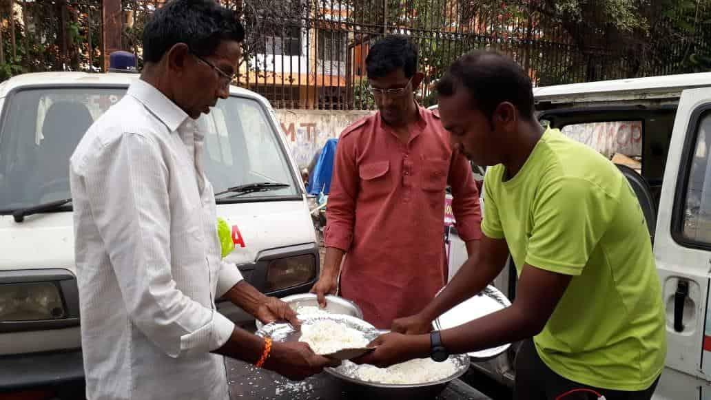 man offering food