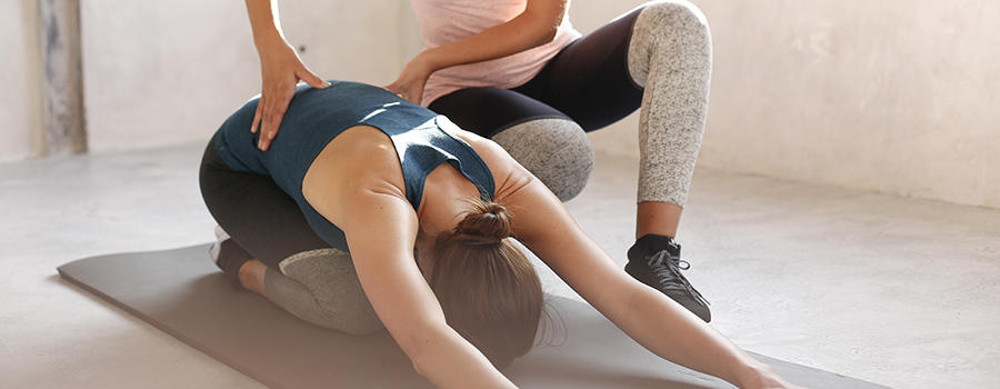 woman assisting in stretching