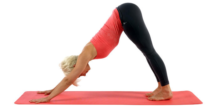 women doing down facing yoga posture
