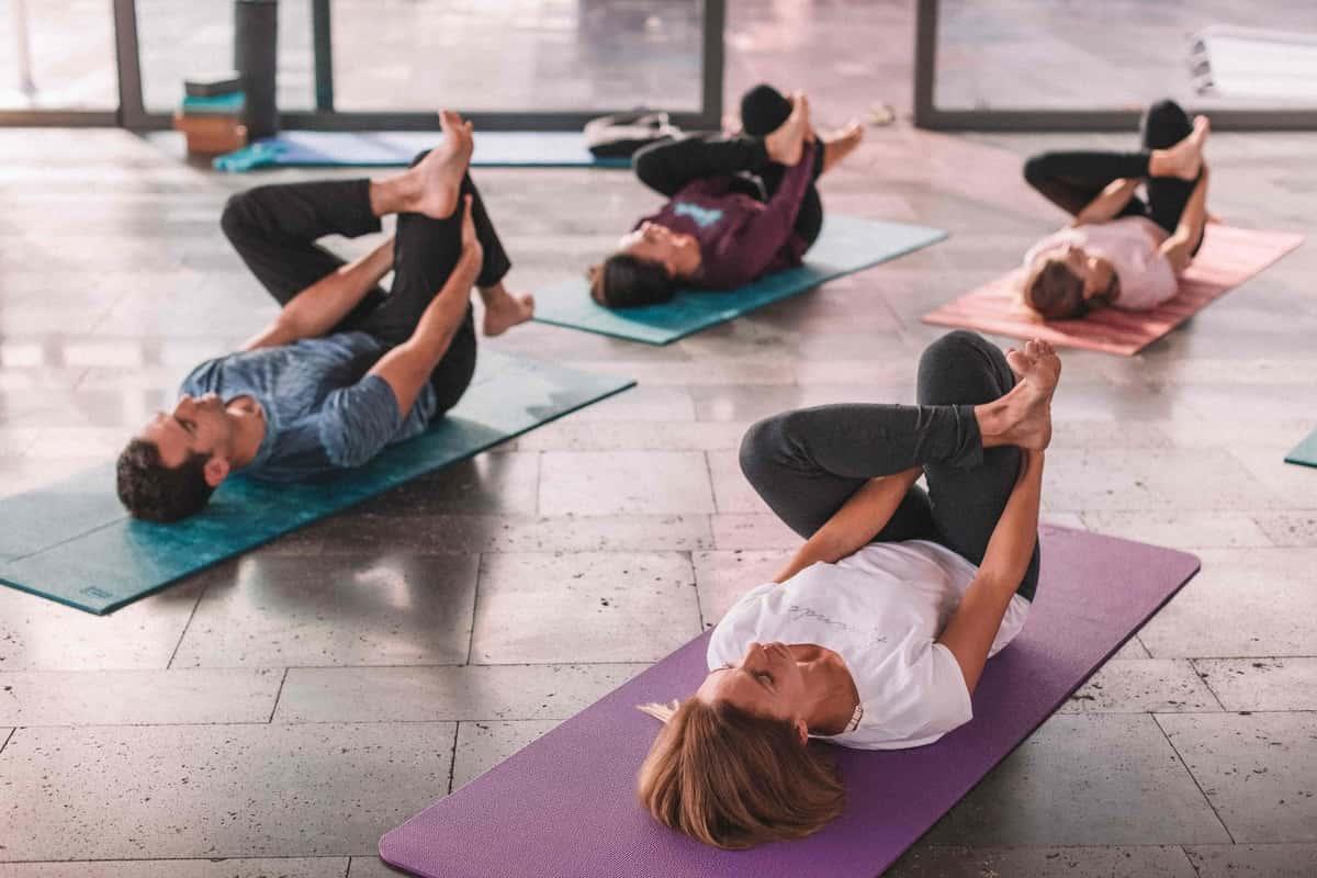 group of people doing hatha yoga