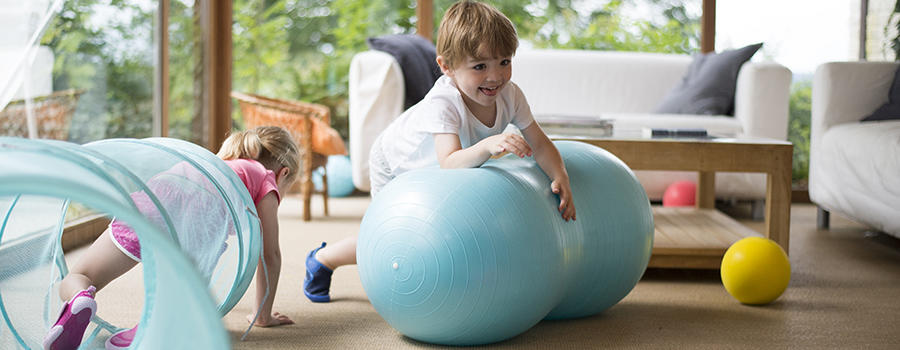 baby playing on gym balls