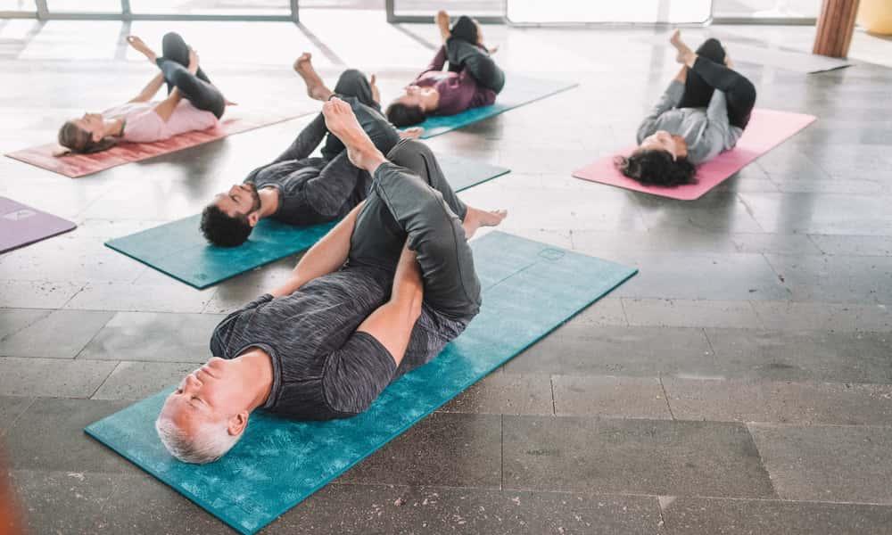 group of people doing yin yoga