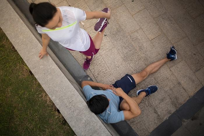 people exercising on the street side