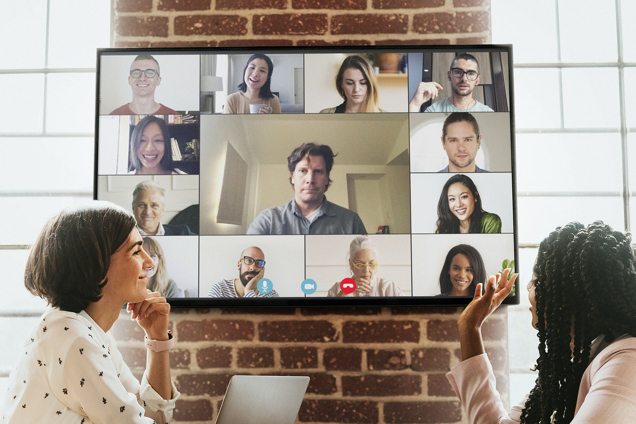 A business owner and business team are meeting with virtual freelancers to discuss a project suggesting how impactful they are when working together.