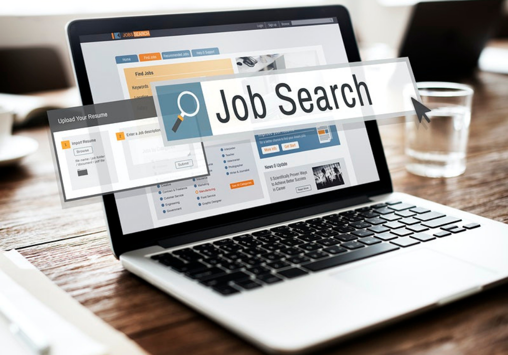 A freelancing platform is open online as a freelancer conducts a job search.